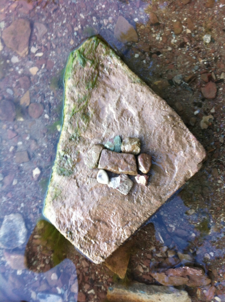 These are rocks I used to symbolize a community surrounding a loved one going through a hard time.
